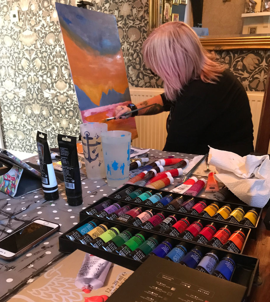 Mandy Singleton Artwork showing the artist at work with acrylics