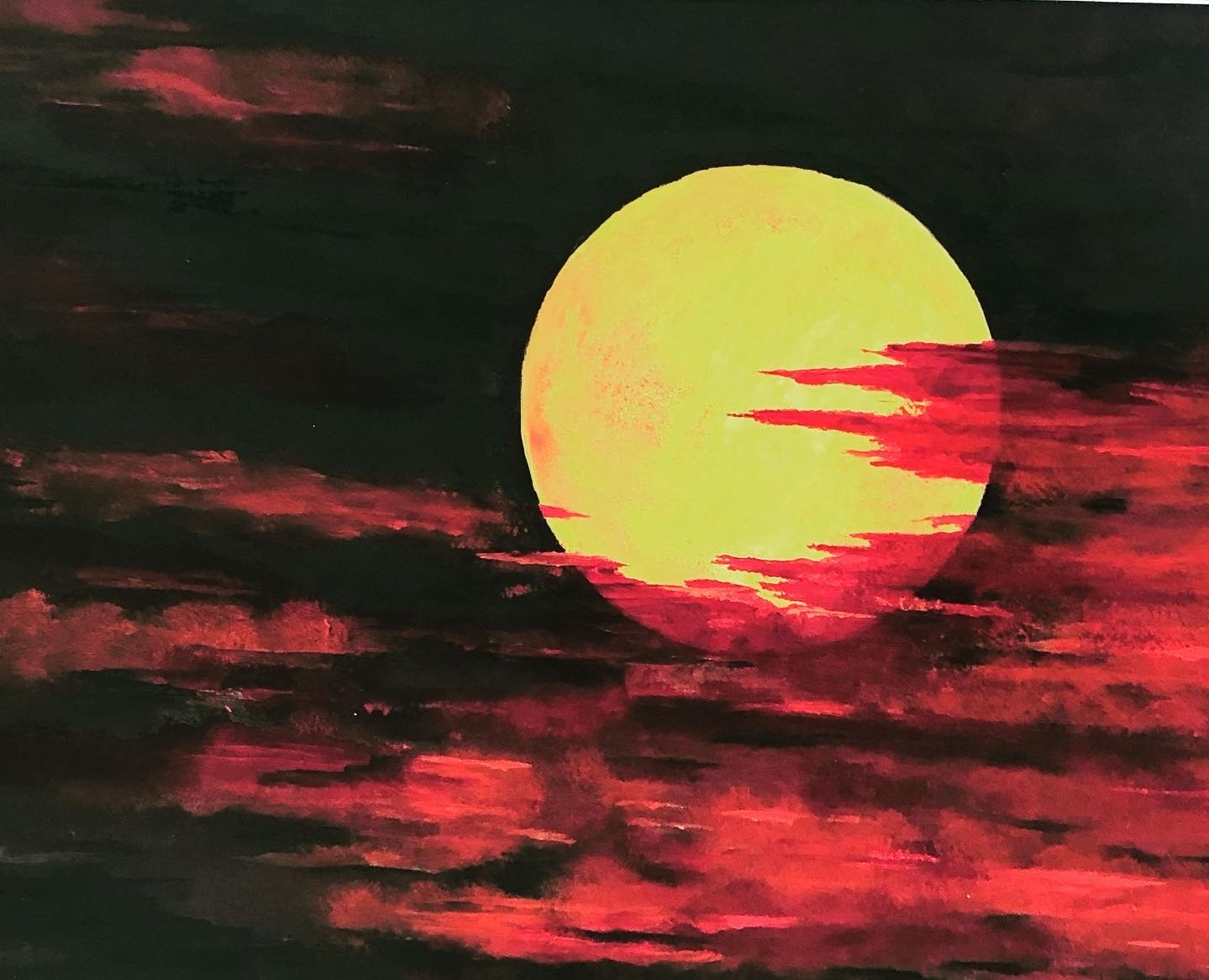 Red Clouds Across The Moon